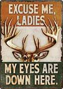 """12 x 17 Metal Sign """"Eyes Are Down Here"""""""